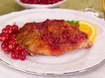 Fried meat with cranberry sauce